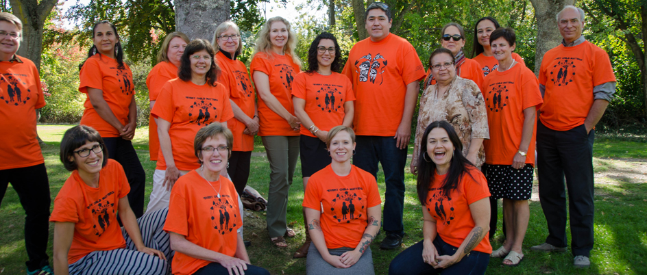 Faculty and staff wearing orange shirts