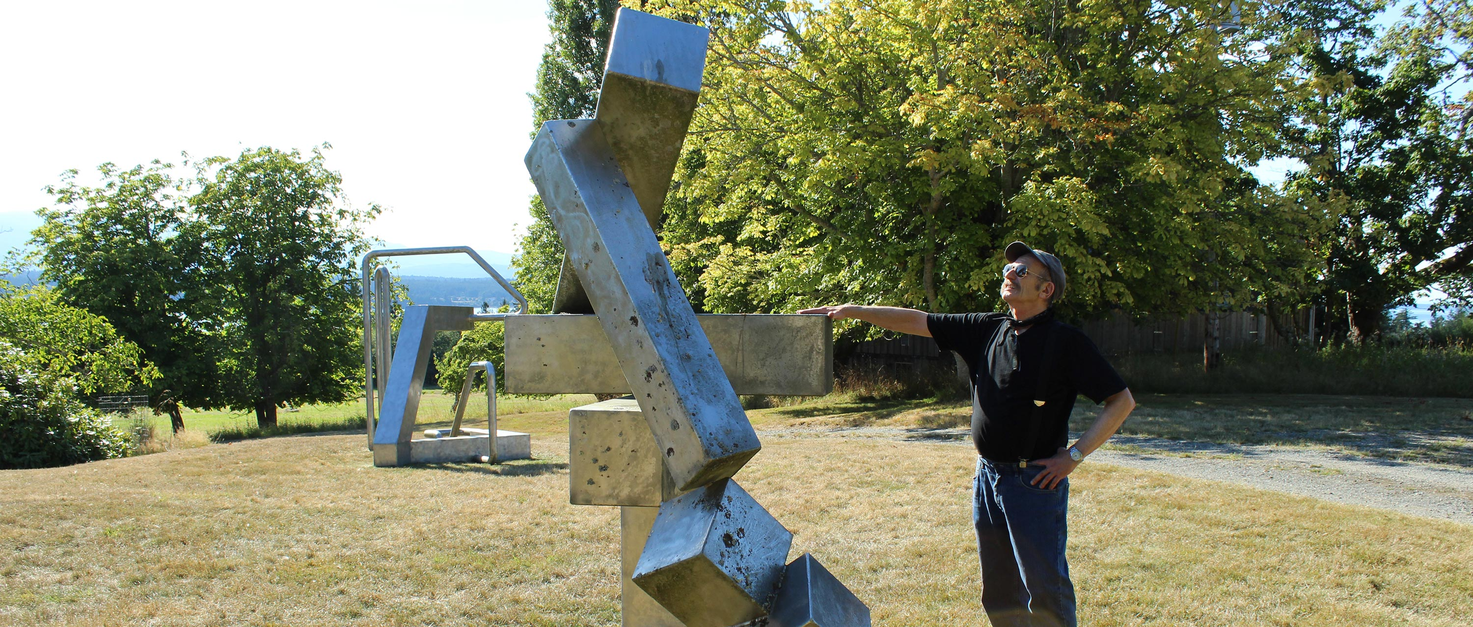 "JEFFREY RUBINOFF WITH HIS SCULPTURE ""SERIES 9-6"""