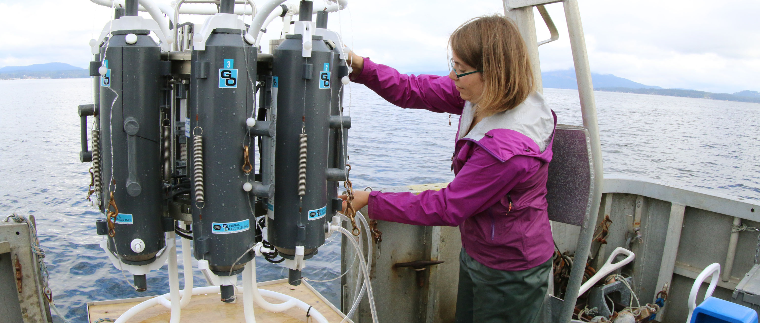 Undergraduate student collecting water samples