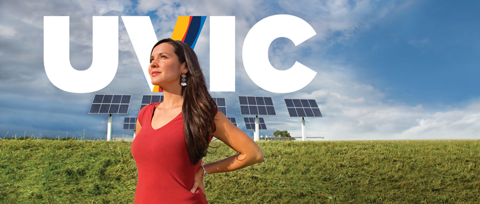 Melina Laboucan in front of solar panels