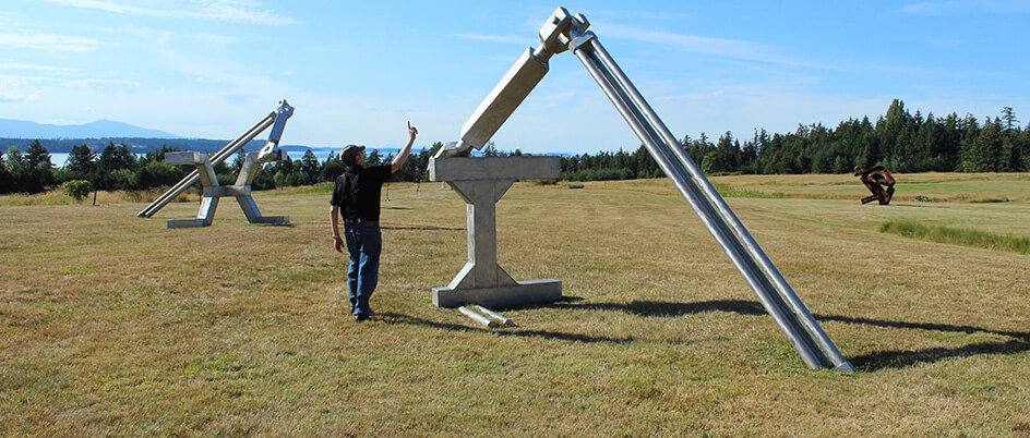 Jeffrey Rubinoff explains one of his sculptures on Hornby Island (Photo: Michelle Tarnopolsky)