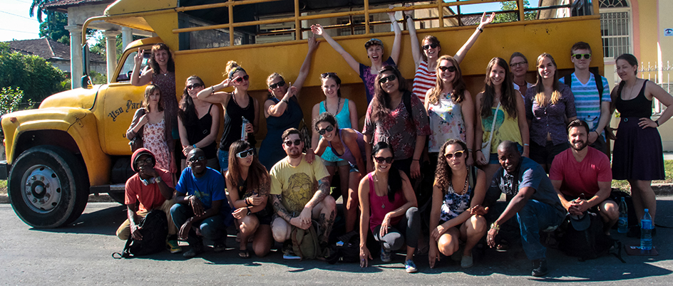 Students from an earlier UVic field school in Cuba posing in front of a bus. Photo: Ained Martinez