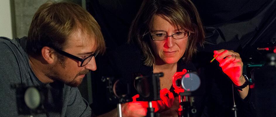 ARC director Kim Venn and graduate student Masen Lamb work at the adaptive optics bench at NRC-Herzberg Institute