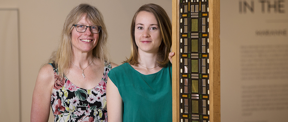 Legacy Art Galleries Director Mary Jo Hughes (left) and UVic alumna and exhibition curator Emerald Johnstone-Bedell with a Frank Lloyd Wright window