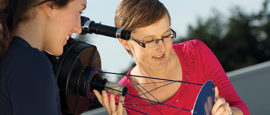 Sara Ellison doing a demonstration using a telescope