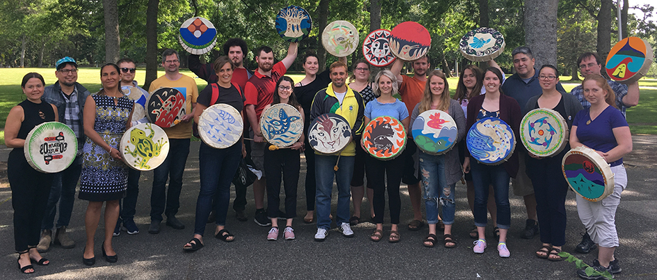Participants of the Indigenous Summer Institute holding drums
