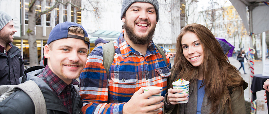 Students drinking hot chocolate during Giving Tuesday event at UVic
