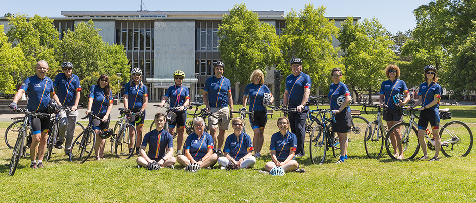 Group of cyclists posing with bicycles at UVic