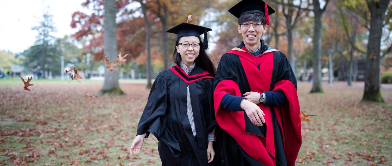 Chorong Kim and Chong Su Kim walking across the UVic campus in the fall