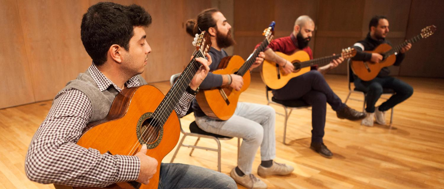 The four members of the Syrian quartet performing on stage with their instruments