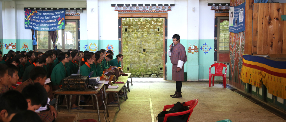 Nima Dorji, senior lecturer with the Jigme Singye Wangchuck School of Law, speaks to high school students in Wangduephodrang, Bhutan