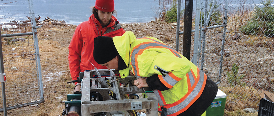 ONC project engineer Ryan Key (in red) and marine equipment specialist Ian Beliveau at work on the Kitamaat Village community observatory platform. Photo: ONC.