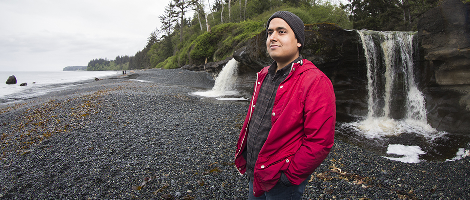 Devesh Bharadwaj in front of a waterfall at Sandcut Beach, Vancouver Island, BC