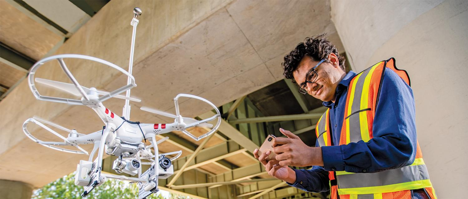PhD candidate Harsh Rathod flies a drone.
