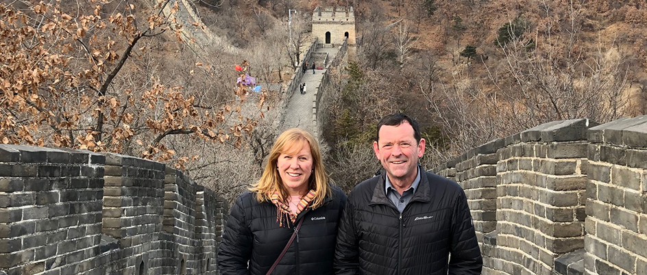 UVic leaders standing on the Great Wall of China