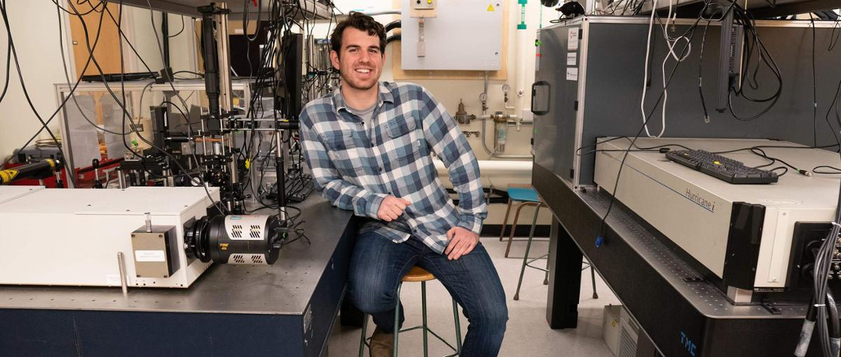 Rory Hills leans on scientific equipment