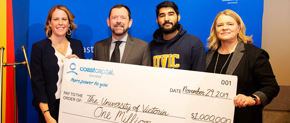 A $1-million dollar cheque is presented from Coast Capital Savings to representatives at UVic.