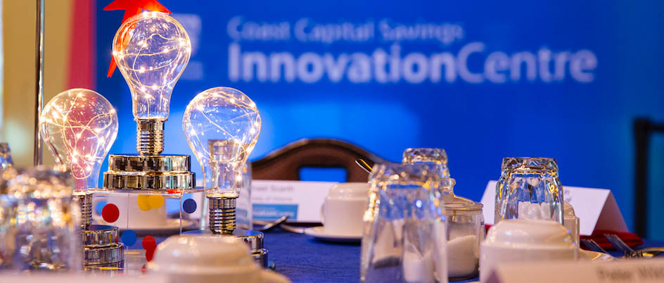 lightbulbs illuminated on a table during a special innovation event