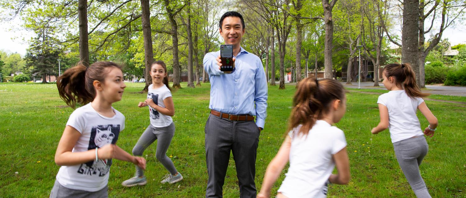 UVic researcher Sam Liu pictured with a youth participant during a demonstration of the Draco smartphone application on campus