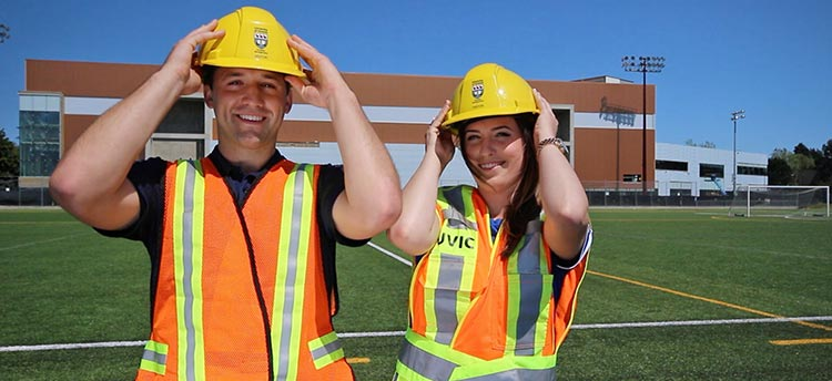 Two Vikes employees with construction hats