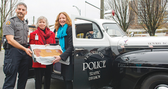 Victoria Police Reserve Constable Devin Warwick, Victoria Genealogical Society President Pat Acton and Heather Dean