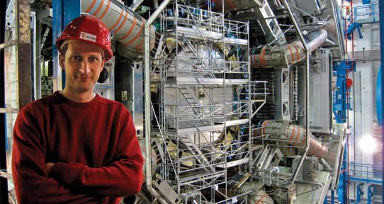 Michel Lefebvre standing in front of the Hadron Collider