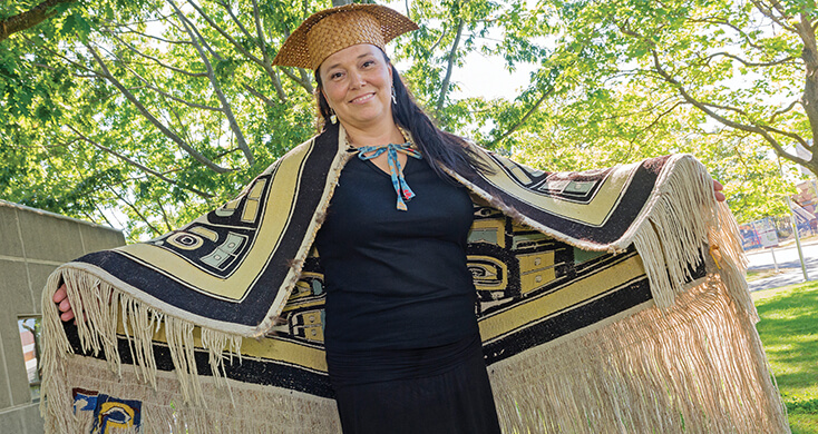 Joye Walkus, BEd (shown above at convocation in June 2015), wears the Chilkat blanket which belonged to her grandfather who taught Joye her first words of the Kwak'wala language.