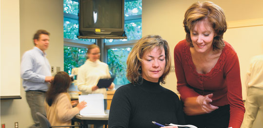 Nursing professor and 3M Teaching Fellow Dr. Gweneth Doane (far right) and former PhD student Lorelei Newton.