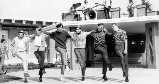 Six male students dance in front of the Student Union Building, 1967