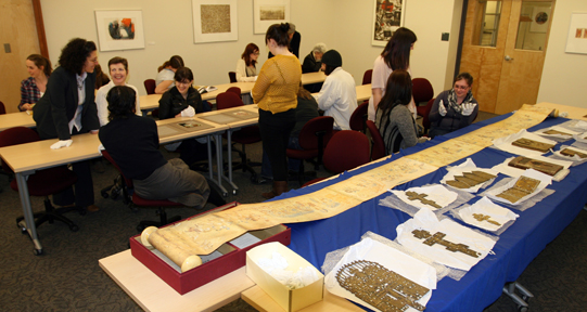 Dr. Evanthia Baboula, of the Department of History in Art, and students using materials from the Brown Collection.