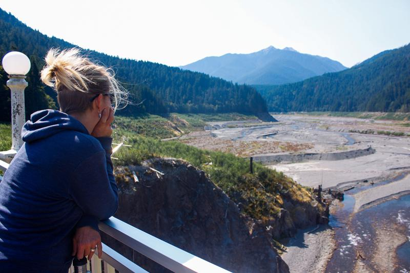 Student looking out over a dam removal site