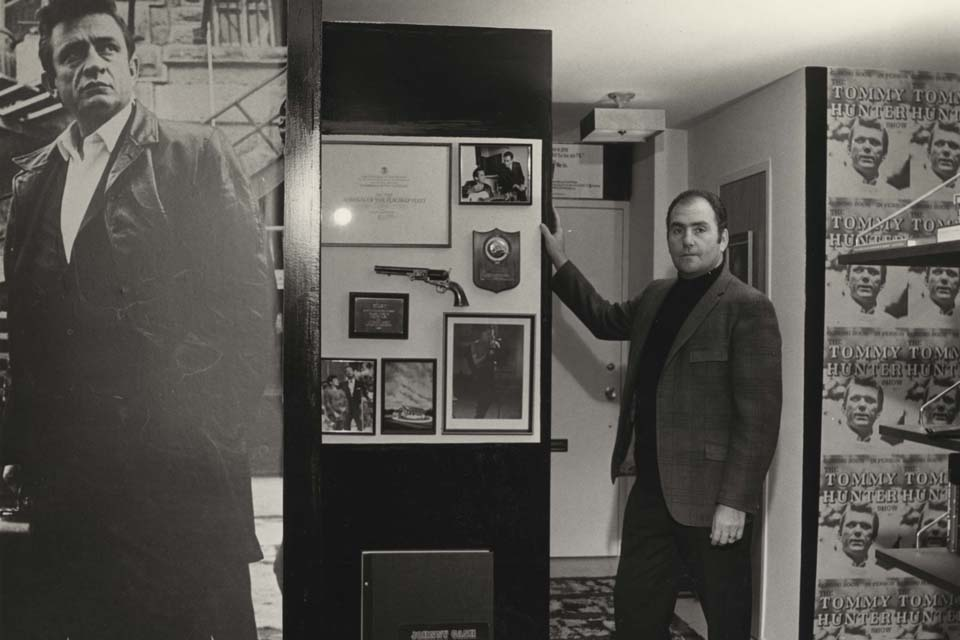 Archival photo of Holiff showing Johnny Cash memorabilia in an office
