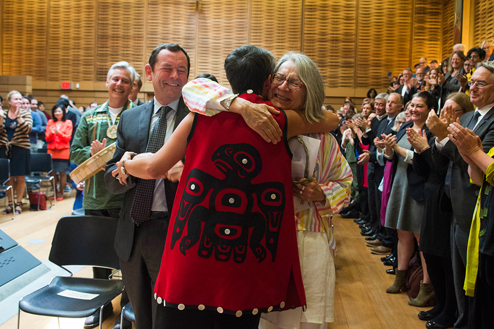 People hugging and clapping at the JID launch event in UVic's First Peoples House