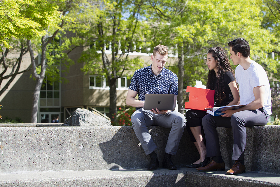 UVic BCom students Hayden Frisch, Julia Greer and Liam Moore on campus