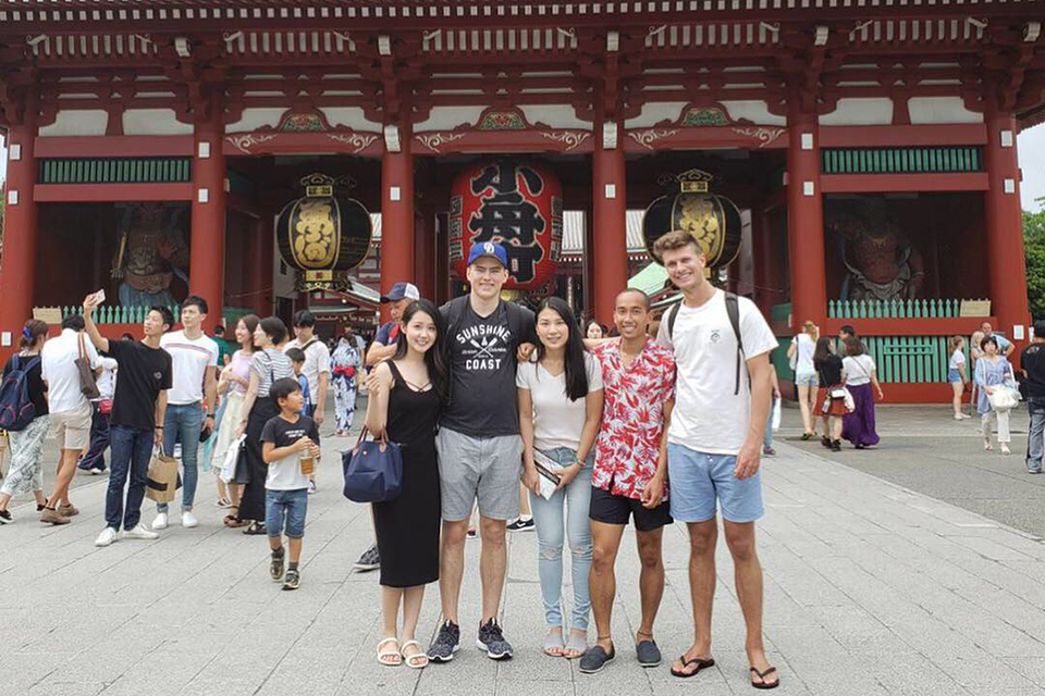 UVic business student with friends in Japan