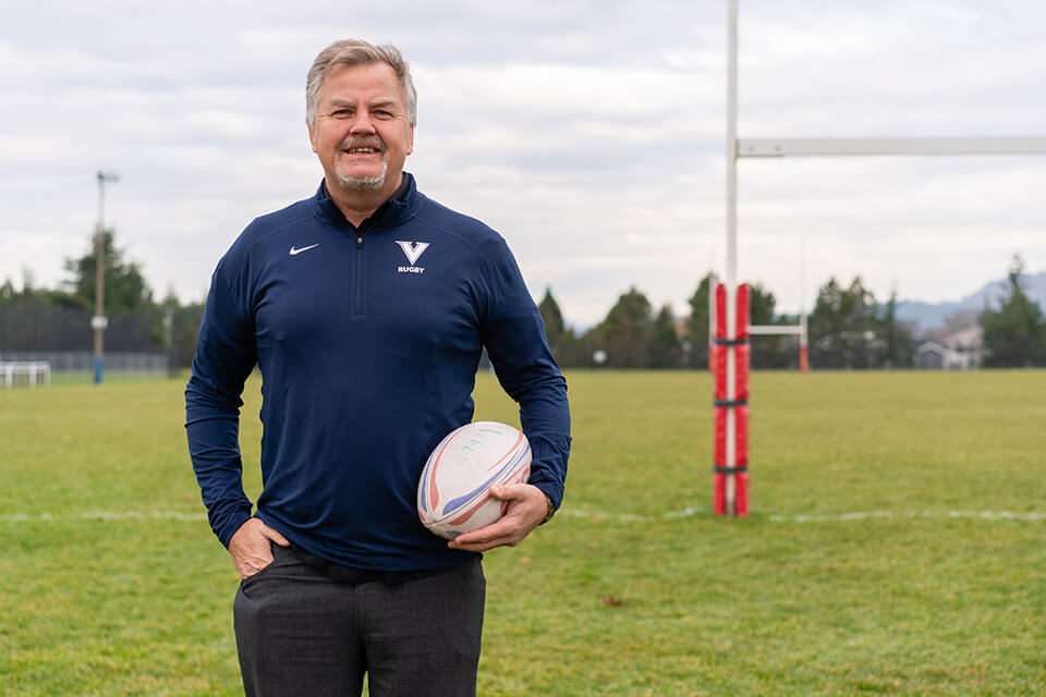 UVic Vike Michael Holmes holding a rugby ball