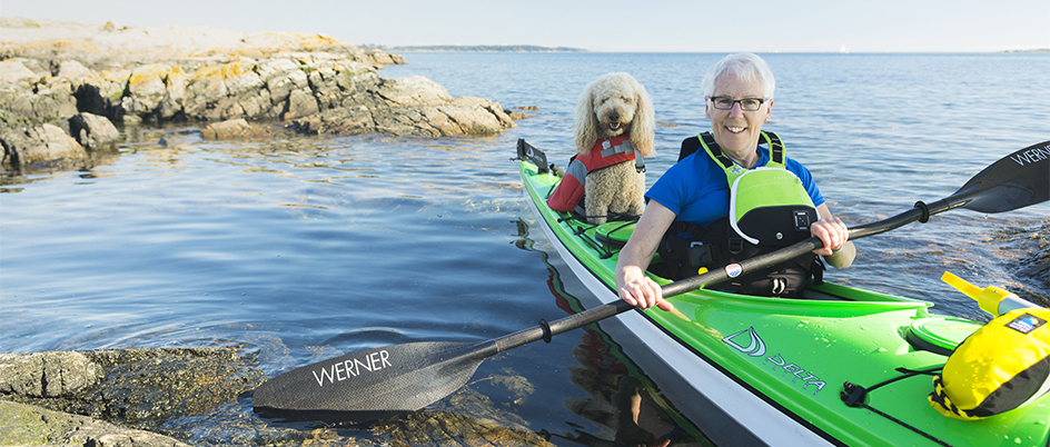 Kate Moran in kayak with her dog