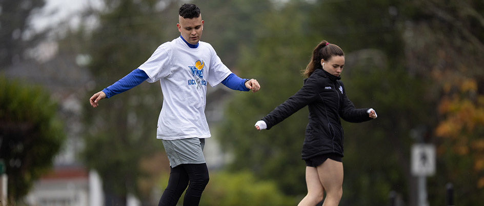 Mackenzie Rigg runs drills with girlfriend Trinity Kettyls, UVic nursing student and Vikes women's soccer player, in a fundraiser initiated by student athletes for the Canadian Brain Tumour Foundation of Canada in Rigg's honour. Credit: Armando Tura/APShutter.com
